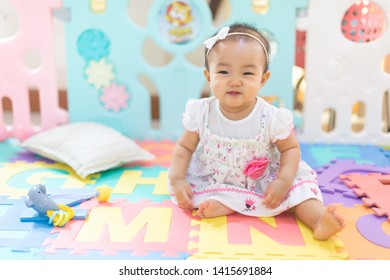 Asian baby girl playing on the floor