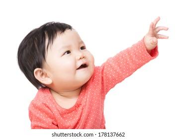 Asian baby girl reaching top