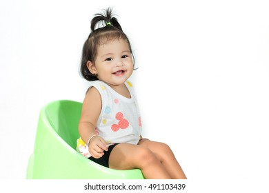 Asian baby girl sit on green chair be happy smile  on white background