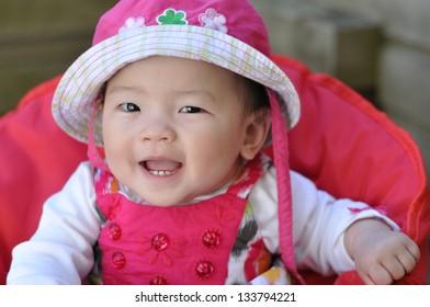 Asian baby girl smiling