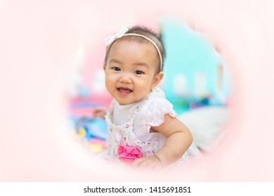 Asian baby girl is smiling