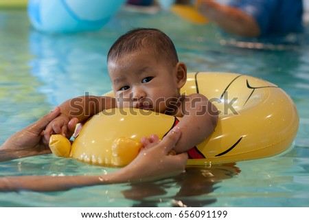 Asian Baby Learn Swim Swim Ring Stock Photo (Royalty Free) 656091199 ...