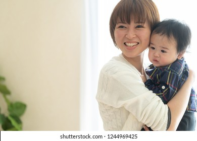 asian baby and mother