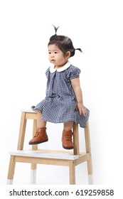 The Asian baby on the white background.