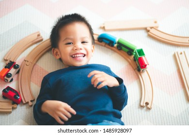 Asian baby playing the wooden toys in the living room.