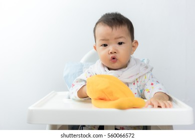 asian baby sitting in high chair white background,baby in home,thailand baby