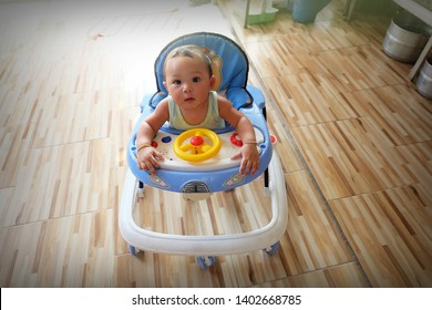Asian baby sitting in the baby walker