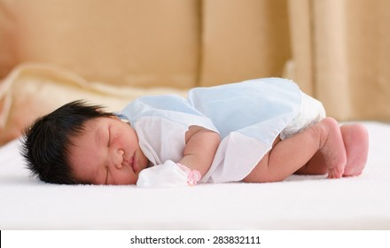 Asian baby sleeping happy dream,Newborn, 4 days after born