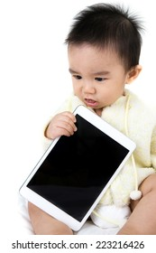 Asian baby with tablet PC on white background .