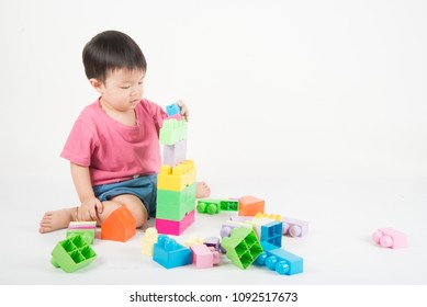 Asian baby Toddler 2 years old playing colorful blocks
