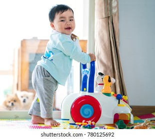 Asian baby training walking with walker toy. This immage can use for baby, family, education, and play concept.
