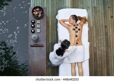 asian back massage therapy spa hot stone