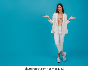 Asian beautiful business women blogger are posture with hand.Full length standing isolated on blue color background with copy space.Concept of online shopping business with Promotion and Sale.