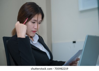 Asian beautiful businesswoman think work in the office,vintage style,dark tone,thailand people