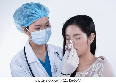 Asian Beautiful Doctor Nurse woman in uniform with stethoscope, rubber gloves, hygiene hat in Medical hospital check up health on female patient for Nebulizer Oxygen Concentrated Mask Tracheostomy