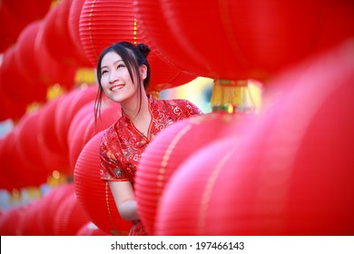 asian beautiful girl in chinese traditional red dress smile in chinese lantern background