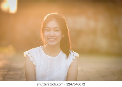Asian beautiful girl has travel with happy and relaxing at Wat Chaiwatthanaram temple in Ayuthaya, Thailand.