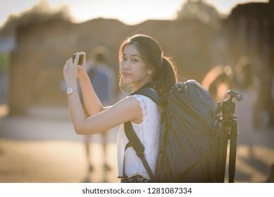 Asian beautiful girl has travel and take a photo at Wat Chaiwatthanaram temple in Ayuthaya, Thailand.