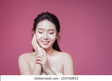 An asian beautiful girl has white and healthy skin.