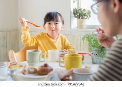 asian beautiful girl having breakfast