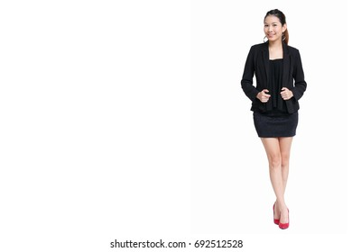 Asian beautiful girl posting in modern smart look in suit and short black skirt isolated on white with copy space