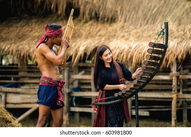 Asian beautiful girl who loves playing Pong Lang is a Thai musical instrument, reed organ, played by the people of the northeast of Thailand, reed mouth organ