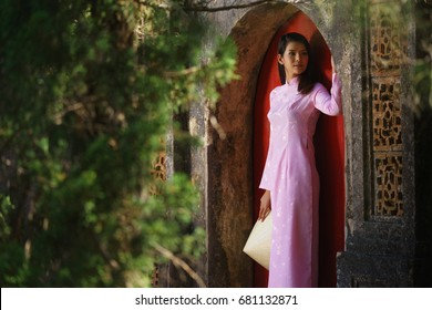 Asian beautiful lady with Vietnam culture tranditional dress, Ao dai is famous traditional costume.