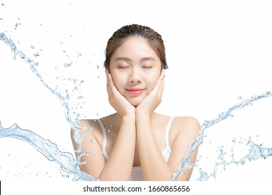 Asian Beautiful model. Beautiful Smiling girl under splash of water with fresh skin on white background.