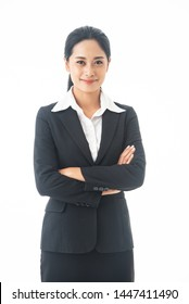 Asian beautiful, smart and young business woman is the executive or manager standing up, thinking and smiling  with happy and confidence  in successful on isolated white background