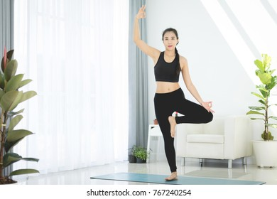 Asian beautiful sports woman performs the exercises at home . With copy space for you text. Fitness, Sport, Yoga