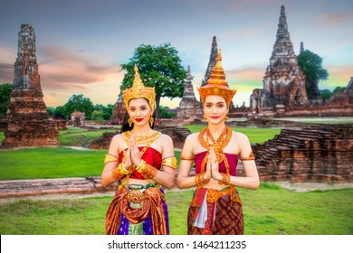Asian Beautiful thai woman in thai traditional dress or culture dress sawasdee,smile and looking  in thailand temple