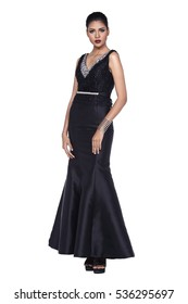 Asian Beautiful very Slim Woman Model Black hair tan skin tall on high heels in black luxury couture long evening gown ball dress, stand pose in studio lighting white background, full length tall