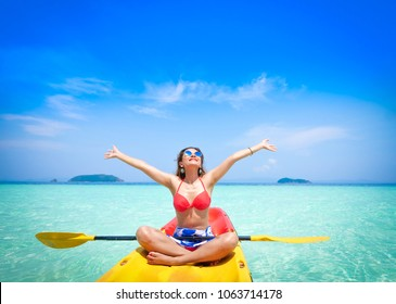 Asian beautiful woman enjoy with kayaking on the blue sea and blue sky view travel summer in andaman sea Thailand beach concept