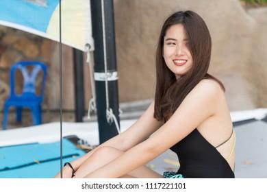 Asian beautiful woman enjoyful on the beach background, portrait sexy female person concept sea travel.