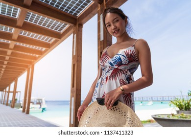 Asian beautiful woman enjoyful traveling sea background, vacation holiday concepts with tropical Maldives island background.