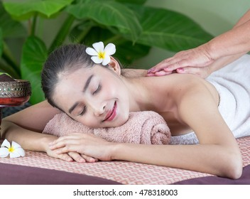 Asian Beautiful Woman Get a massage and spa. Specialists from massage.