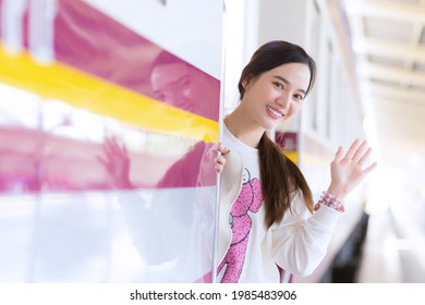 Asian beautiful woman say bye bye to her family due to working in the city by train or she arrive say welcome to home at the station.