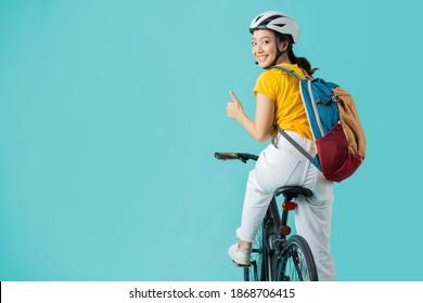 Asian beautiful woman, she is riding a city bike to work