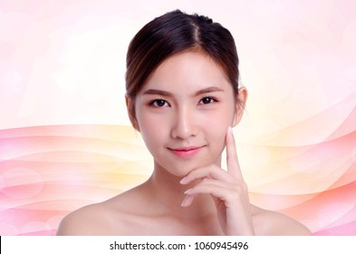 Asian beautiful woman smiling and touching her face, isolated on pastel background. natural makeup, SPA therapy, skincare, cosmetology and plastic surgery concept.with free copyspace.