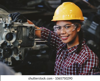 Asian beautiful woman working engineering in industry smiling and happy face