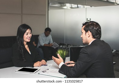 Asian beautiful  young female candidate  presents  herself to interviewer with big smiled for getting job in office
