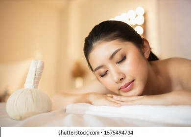Asian Beautiful, young and healthy woman in spa salon. Massage treatment spa room  . Traditional medicine and healing concept.