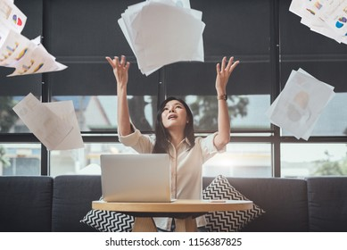 Asian beauty businesswoman throwing paperwork into the air. Successful and achievement concept. Business and Occupation concept. Freelance and business owner theme.