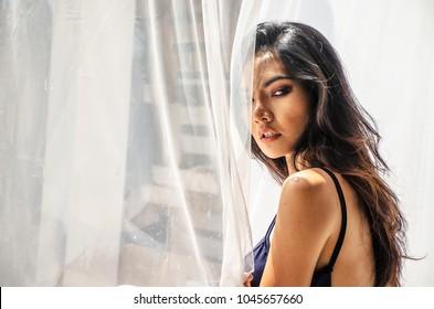 Asian beauty face closeup portrait with look sexy elegant lady. Studio shot.