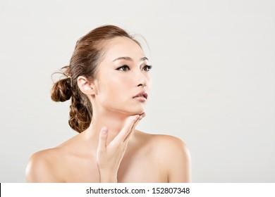 Asian beauty face closeup portrait with clean and fresh elegant lady. Studio shot.
