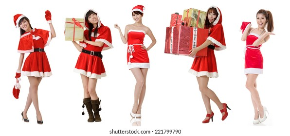 Asian beauty in Santa Claus dress with bag posing against white background.