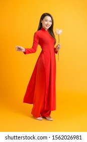 Asian beauty woman. Beautiful happy Vietnamese girl wearing national traditional red ao dai dress