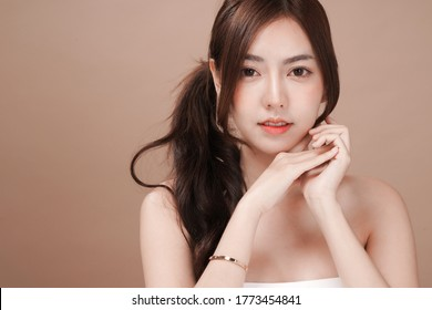 Asian beauty woman with natural makeup cosmetic and plastic surgery concept, Isolated mocha brown background