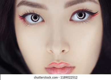 Asian beauty woman skin care close-up. Beautiful young girl with perfect skin face looking at camera. Isolated on gray background. Tender sensual mixed race Asian Caucasian female in studio. Fashion