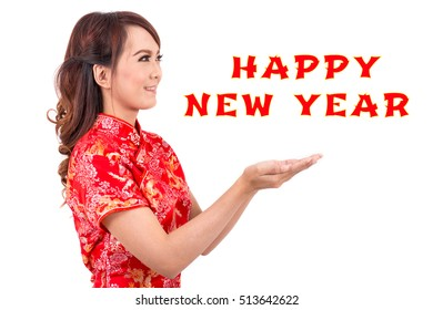 "Asian beauty women wear red dress cheongsam or qipao is chinese traditional celebrate "" Happy new year ""."